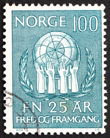upholding: NORWAY - CIRCA 1970: a stamp printed in the Norway shows Olive Wreath and Hands Upholding Globe, 25th Anniversary of the United Nations, circa 1970