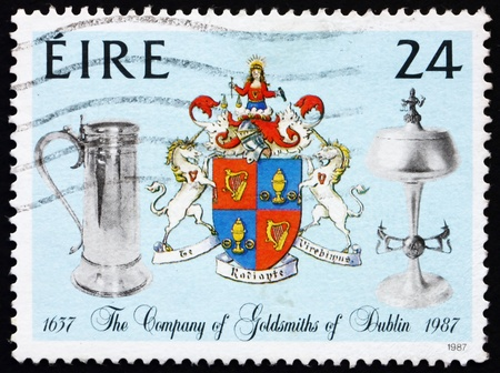 ewer: IRELAND - CIRCA 1988: a stamp printed in the Ireland shows Ewer and Chalice, Company Crest, 350th Anniversary of Company of Goldsmiths, circa 1988 Stock Photo