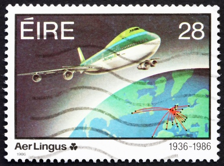 IRELAND - CIRCA 1986: a stamp printed in the Ireland shows Jet plane and Earth, 1986, 50th Anniversary of Aer Lingus, circa 1986 Stock Photo - 12847928