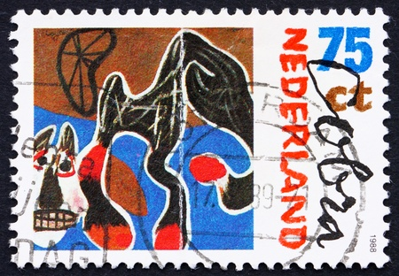 constant: NETHERLANDS - CIRCA 1987: a stamp printed in the Netherlands shows Fallen Horse, 1950, Painting by Constant, Artist Belonging to Cobra, circa 1987 Stock Photo