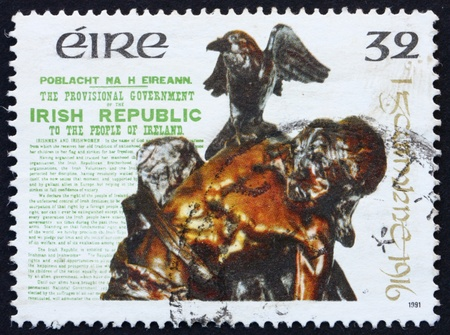 IRELAND - CIRCA 1991: a stamp printed in the Ireland shows Statue Death of Cuchulainn by Oliver Sheppard, 1916 Proclamation, circa 1991 photo