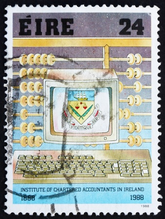 IRELAND - CIRCA 1988: a stamp printed in the Ireland shows Abacus and Personal Computer, Centenary of Institute of Chartered Accountants, circa 1988 Stock Photo - 12847427