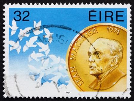 IRELAND - CIRCA 1994: a stamp printed in the Ireland shows Sean McBride, Statesman, Nobel Peace Prize Winner, circa 1994 Stock Photo - 12847424