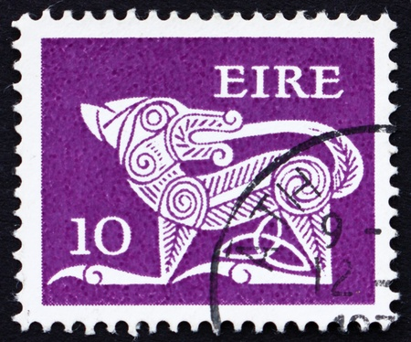 IRELAND - CIRCA 1969: a stamp printed in the Ireland shows Dog from Ancient Brooch, County Kilkenny, circa 1969 photo