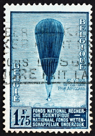 ascent: BELGIUM - CIRCA 1992: a stamp printed in the Belgium shows Auguste Piccard�s Balloon, Ascent to the Stratosphere, circa 1992 Stock Photo