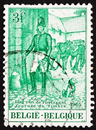 BELGIUM - CIRCA 1965: a stamp printed in the Belgium shows Postmaster, c. 1833, Street Scene, circa 1965 photo