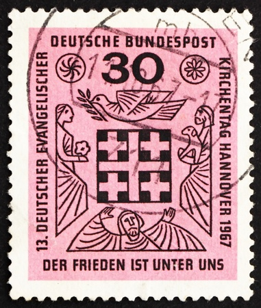 GERMANY - CIRCA 1967: a stamp printed in the Germany shows Peace is Among Us, 13th Meeting of German Protestants, Hanover, circa 1967 photo