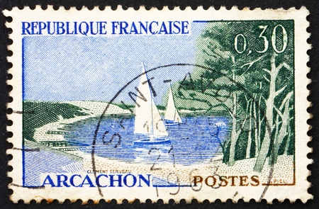 FRANCE - CIRCA 1961: a stamp printed in the France shows Beach and Sailboats, Arcachon, France, circa 1961 photo