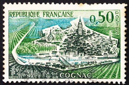 postal office: FRANCE - CIRCA 1961: a stamp printed in the France shows View of Cognac, France, circa 1961