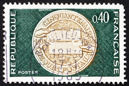 FRANCE - CIRCA 1968: a stamp printed in the France shows Commemorative Medal, 50th Anniversary of Postal Checking Service, circa 1968 photo