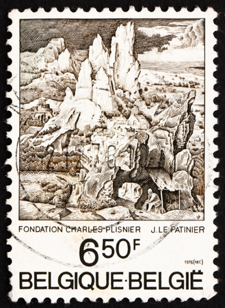 BELGIUM - CIRCA 1976: a stamp printed in the Belgium shows St. Jerome in the Mountains, by Le Patinier, circa 1976 photo