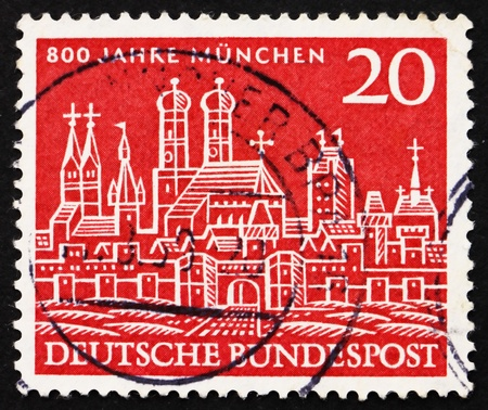 GERMANY - CIRCA 1958: a stamp printed in the Germany shows View of Old Munich, 800th Anniversary of Munich, circa 1958 Stock Photo - 12840128