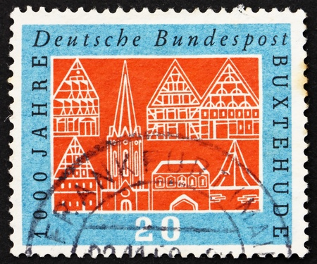 GERMANY - CIRCA 1959: a stamp printed in the Germany shows Buildings, Buxtehude, Millennium of Town of Buxtehude, circa 1959 photo
