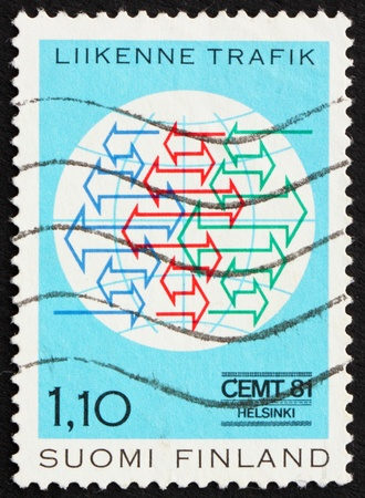 FINLAND - CIRCA 1981: a stamp printed in the Finland shows Traffic Conference Emblem, European Conference of Ministers of Transport, circa 1981 photo