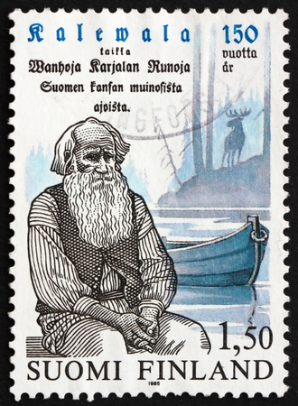 FINLAND - CIRCA 1985: a stamp printed in the Finland shows Pedri Semeikka, Rune Singer, 150th Anniversary of Kalevala, circa 1985 Stock Photo - 12846473