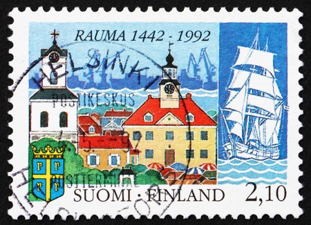 FINLAND - CIRCA 1992: a stamp printed in the Finland shows Town of Rauma, 550th Anniversary, circa 1992 photo