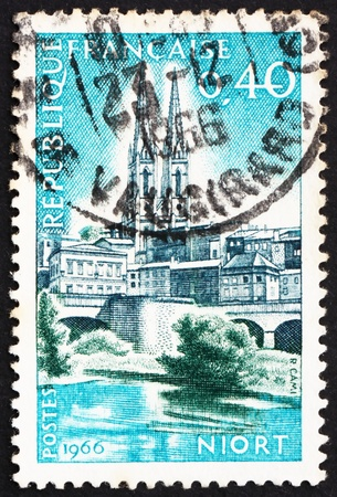 FRANCE - CIRCA 1966: a stamp printed in the France shows St. Andrew�s and Sevre River, Niort, France, circa 1966 Stock Photo - 12840096