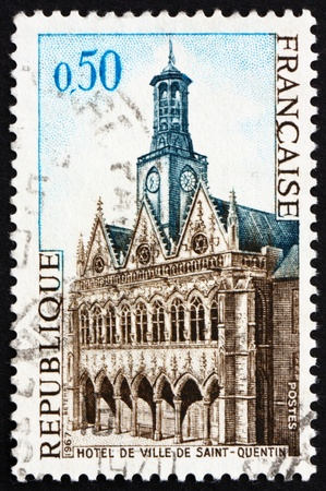 FRANCE - CIRCA 1967: a stamp printed in the France shows City Hall, Saint-Quentin, France, circa 1967 Stock Photo - 12840095