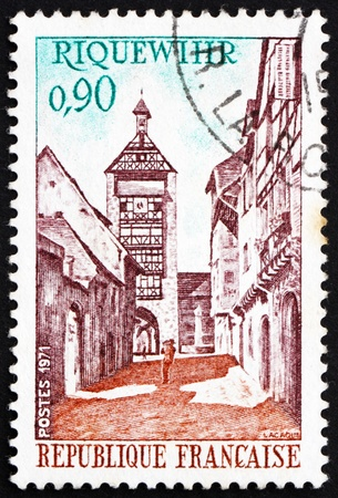 FRANCE - CIRCA 1971: a stamp printed in the France shows Dolder Tower and Street, Riquewihr, France, circa 1971 Stock Photo - 12840094