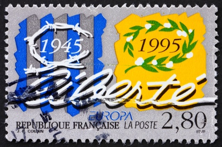 FRANCE - CIRCA 1995: a stamp printed in the France shows Barbed Wire and Laurel Wreath, 50th Anniversary of End of World War II, circa 1995 photo