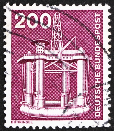 GERMANY - CIRCA 1982: a stamp printed in the Germany shows Oil Drilling Platform, circa 1982 photo
