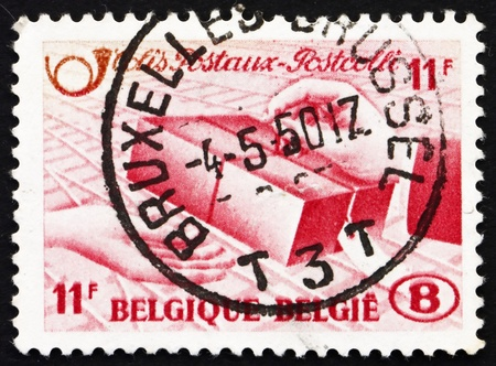 BELGIUM - CIRCA 1948: a stamp printed in the Belgium shows Delivery of Parcel, circa 1948 photo