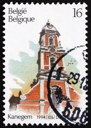 BELGIUM - CIRCA 1994: a stamp printed in the Belgium shows Church of St. Bavo�s, Kanegem, Belgium, circa 1994 photo