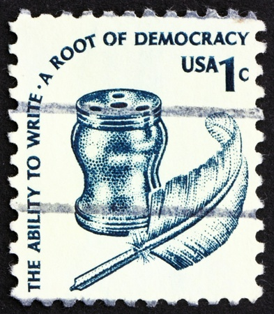 UNITED STATES OF AMERICA - CIRCA 1975: a stamp printed in the USA shows Inkwell and Quill, circa 1975 photo