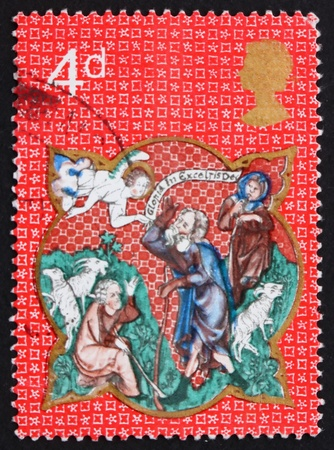 appearing: GREAT BRITAIN - CIRCA 1970: a stamp printed in the Great Britain shows Angel appearing before the shepherds, from de Lisle Psalter, Christmas, circa 1970 Stock Photo