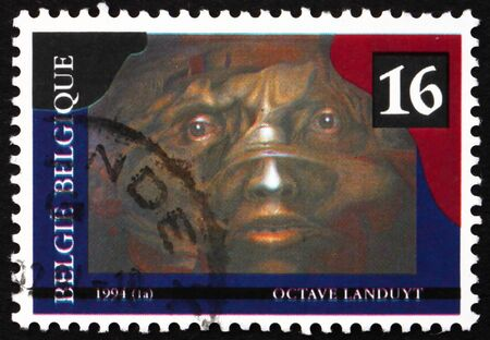 BELGIUM - CIRCA 1994: a stamp printed in the Belgium shows The Malleable Darkness, Painting by Octave Landuyt, circa 1994 Stock Photo - 12849523
