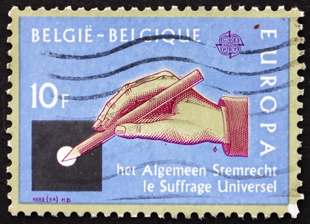 BELGIUM - CIRCA 1982: a stamp printed in the Belgium shows Hand with Pencil, Universal Suffrage, circa 1982 photo