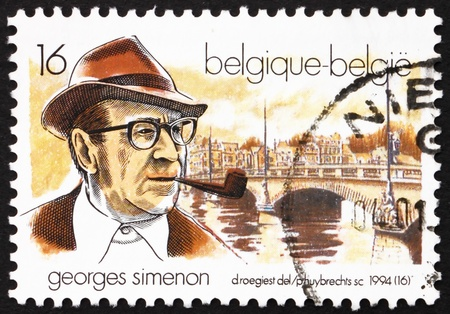 BELGIUM - CIRCA 1994: a stamp printed in the Belgium shows Georges Simenon, Writer, circa 1994 Imagens - 12877346