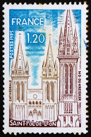 postal office: FRANCE - CIRCA 1975: a stamp printed in the France shows Saint Pol de Leon, Towers of The Kreisker Chapel and The Saint Paul Aurelian Cathedral, France, circa 1975