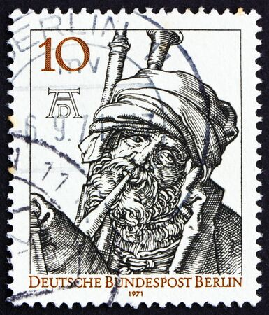printmaker: GERMANY - CIRCA 1971: a stamp printed in the Germany, Berlin shows Bagpipe Player by Durer, 500th anniversary of the birth of Albrecht Durer, painter and engraver, circa 1971