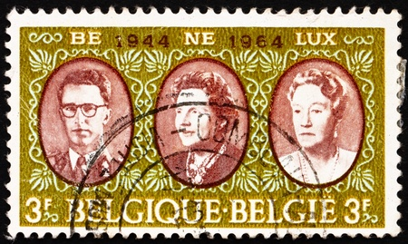 BELGIUM - CIRCA 1964: a stamp printed in the Belgium shows King Baudouin, Queen Juliana and Grand Duchess Charlotte, Benelux, circa 1964