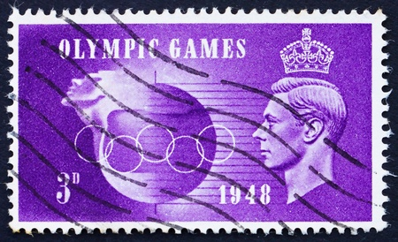 wembley: GREAT BRITAIN - CIRCA 1948: a stamp printed in the Great Britain shows King George VI and Olympic Rings, Olympic Games 1948 at Wembley, circa 1948