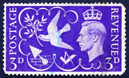 GREAT BRITAIN - CIRCA 1946: a stamp printed in the Great Britain shows King George VI and Symbols of Peace and Industry, circa 1946