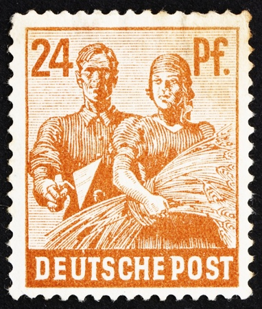 GERMANY - CIRCA 1947: a stamp printed in the Germany shows Reaping Wheat, circa 1947 Stock Photo - 12935933