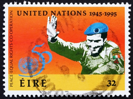 united nations: IRELAND - CIRCA 1995: a stamp printed in the Ireland shows UN Soldier, 50th Anniversary of United Nations, circa 1995