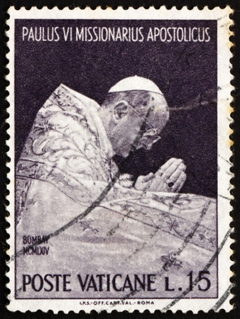 VATICAN - CIRCA 1964: a stamp printed in the Vatican shows Pope Paul VI at Prayer, Trip of Pope Paul VI to India, circa 1964 Stock Photo - 13021506