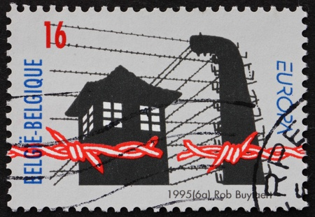 prison guard: BELGIUM - CIRCA 1995: a stamp printed in the Belgium shows Broken Barbed Wire, Prison Guard Tower, 50th Anniversary of Liberation of Concentration Camps, circa 1995