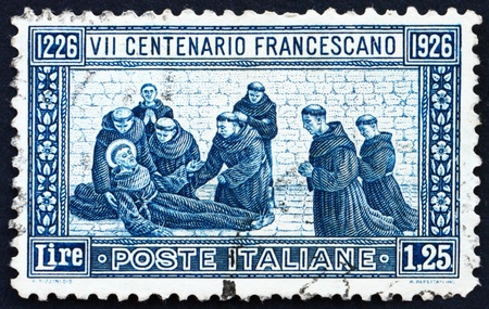 ITALY - CIRCA 1926: a stamp printed in the Italy shows St. Francis' Death, circa 1926 Stock Photo - 13140464