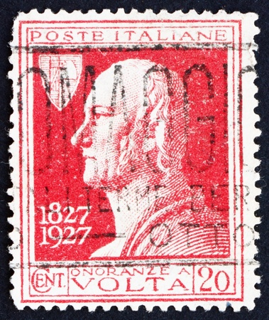 electric cell: ITALY - CIRCA 1927: a stamp printed in the Italy shows Count Alessandro Volta, Physicist, Invention of Electric Cell, Battery, circa 1927
