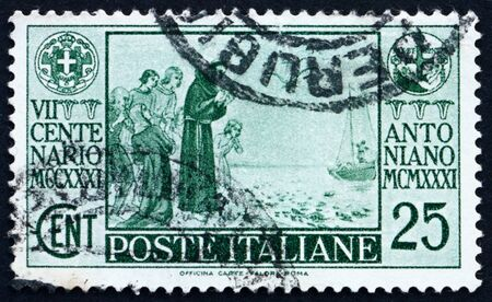 ITALY - CIRCA 1931: a stamp printed in the Italy shows St. Anthony of Padua Preaching to the Fishes, circa 1931 Stock Photo - 13140454