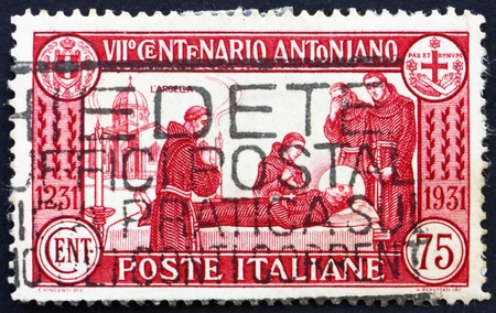 friar: ITALY - CIRCA 1931: a stamp printed in the Italy shows St. Anthony's Death, circa 1931