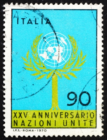 un used: ITALY - CIRCA 1970: a stamp printed in the Italy shows Tree and UN Emblem, 25th Anniversary of the United Nations, circa 1970 Editorial