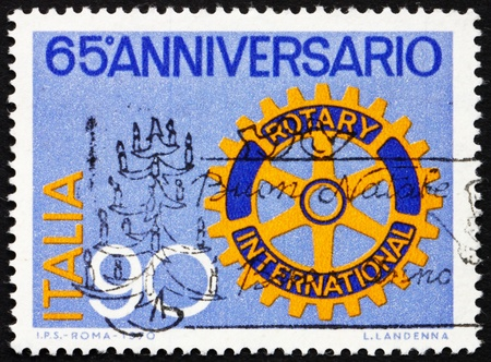ITALY - CIRCA 1970: a stamp printed in the Italy shows Rotary Emblem, 65th Anniversary of the Rotary International, circa 1970