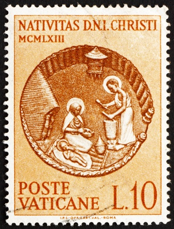VATICAN - CIRCA 1963: a stamp printed in the Vatican shows African Nativity Scene, Sculpture by the Burundi Artist Andreas Bukuru, circa 1963 Stock Photo - 13154874