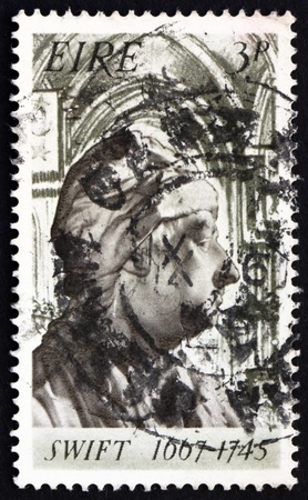 satirist: IRELAND - CIRCA 1967: a stamp printed in the Ireland shows Jonathan Swift�s Bust and St. Patrick�s Cathedral, Dublin, circa 1967