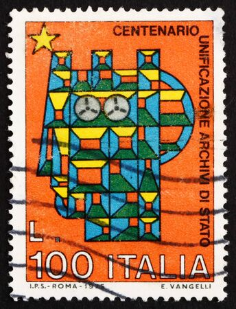ITALY - CIRCA 1975: a stamp printed in the Italy shows Stylized Syracusean Italia, Centenary of Unification of the State Archives, circa 1975 Stock Photo - 13182551